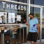 Fed by Threads co-founder Alok Appadurai, standing outside of the clothing shop and next to the Local First Arizona sticker.  photo: Deanna Chevas