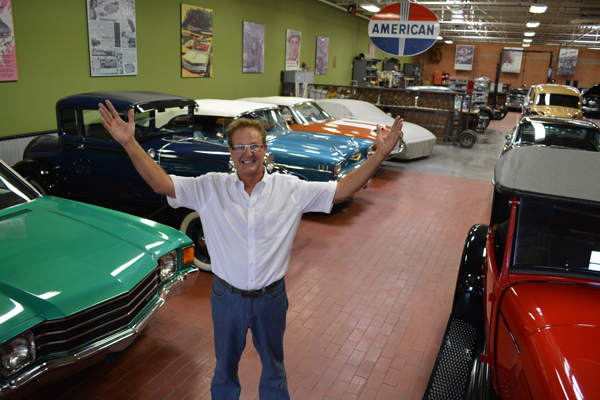 John Sewell, one of the three co-owners/partners of HiSpeed Rods & Customs, inside the showroom that is filled with classic cars and auto memorabilia. photo: Steve Renzi