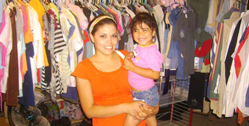 Kenya Aguilera and her daughter at her in-home clothing resale shop; Nogales, Sonora, Mexico. photo: Bill Holliday
