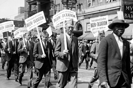 """The Great Depression struck the final blow against Prohibition. Here, marchers in Detroit bear signs reading, """"Beer for Taxation, Jobs for Millions"""" ca. 1930.  Credit: Walter P. Reuther Library, Wayne State University"""